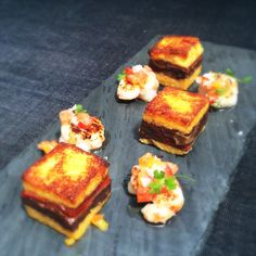 """Your weekend just got tastier with this tapas special from Chef Luis Bollo: BOCADILLO DE MORCILLA PIQUILLOS Y MAIZ – Blood sausage, piquillo peppers, corn meal """"bocadillo,"""" seared rock shrimp, jardinera."""
