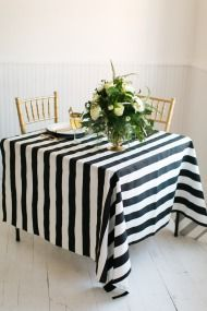 New Year's Eve Wedding Shoot | Style Me Pretty. The bold stripes and gold make for beautiful party decor.