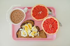 Whole grain spelt frying pan bread w sliced boiled egg, hot oat chocolate, blood grapefruit
