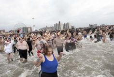 People taking part in the Coney Island Polar Bear Club's annual New Year's Day Polar Bear Swim enter the water in New York's Coney Island January 1, 2013.