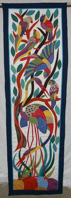 This is a truly stunning piece. Using inspiration from ancient Egyptian tomb artwork, this design includes cranes and birds in a wetland scene.
