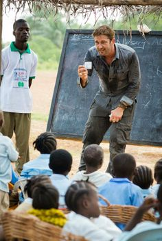 """Gerry with the kids in Liberia.  """"What does the Lion do?"""" - photo credit www.chriswatt.com"""