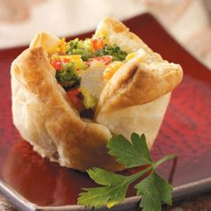 Broccoli Chicken Cups Recipe Lunch and Snacks, Appetizers with cooked chicken breasts, condensed cream of chicken soup, frozen chopped broccoli, plum tomatoes, carrots, dijon mustard, garlic cloves, pepper, frozen pastry puff sheets, grated parmesan cheese