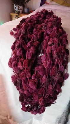 """'arm knitted..open weave..deep burghundy/wine  10"""" x 104""""     $15. 00'"""