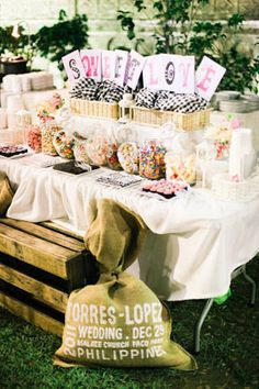 A table laden with sweets added a playful touch to the reception. In keeping with the wedding's theme, the area was decorated with wicker baskets, gingham and burlap fabrics, and wooden crates.