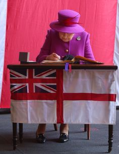 thebritishnobility: Queen Elizabeth signs a guestbook at the Royal navy's HMS Ocean at Her Majesty's Naval Base Devonport, Plymouth, March 20, 2015