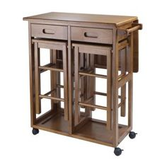 KEEP this for awhile.  Kitchen cart. Nice built-in eating center.  Idea could be designed into kitchen cabinet plans--store-away stools and drop-leaf eating area.  If built against the wall, have drop leaf come down over those stools.  Pull out, flip up, eat.