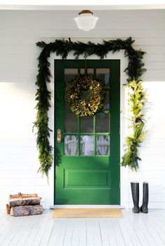 T he door is dressed in garland and holly.           The amaryllis are growing like graceful winter swans...            that flourish...