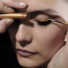 Gold winged eye liner