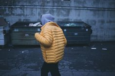 Although dumpster diving isn't illegal, the laws surrounding it aren't well defined. Learn about your rights as a dumpster diver with us. Yellow Puffer Jacket, Puffy Jacket, Billie Eilish, Hauling Services, Walking Jackets, Dumpster Rental, Dumpster Diving, Get Ripped