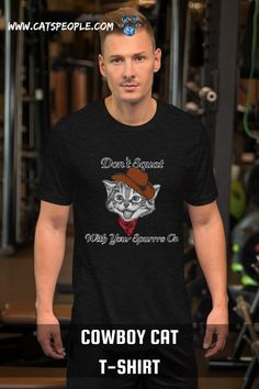 """""""Don't squat with your spurrs on!"""" a famous cowboy saying with a can pun! this cowboy cat design is purrfect for cat owners and cat lovers who are cowboy fans! A unique and cute design that will draw a smile on every cat mom and cat dad's face. #catlovertshirt #catcowboy #catmomtshirt #funnycattshirt#catdadtshirt #catladytshirt #funnycat #cowboycat #funnycatcowboy #funnycat #catpuntshirt"""