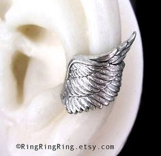 100% Solid .925 Sterling Silver. Angel, Archangel wing ear cuff cartilage earrings. Unique handmade jewelry by RingRingRing on Etsy. Please choose the finish from the options. One is lightly antiqued by oxidizing, and polished to show the details of the design. And the other is shiny