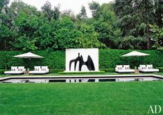 Set against a white backdrop, a black Alexander Calder sculpture appears to dance above the water in a pool at a private home in Holmby Hills, California. Outdoor Landscaping, Outdoor Gardens, Modern Gardens, Outdoor Rooms, Landscaping Ideas, Outdoor Living, Outdoor Furniture, Garden Landscape Design, Landscape Architecture