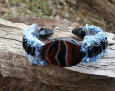 This bracelet has a beautiful agate centerpiece. There are black rectangle shaped crystals sewn down each side. They are double sewn and double knotted. The ends each have a glass black faceted cone shaped bead. This bracelet will fit a small wrist only. Diy Denim Bracelets, Denim Ideas, Topaz Color, Fabric Jewelry, Clay Beads, Friendship Bracelets, Jean Crafts, Black Rectangle, Levis