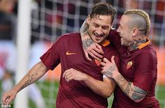 The 40-year-old Italian forward is congratulated by Radja Nainggolan after scoring his goal