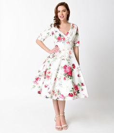 Were devoted to Delores, darling! An elegant white dress rich in 1950s vintage appeal fresh from Unique Vintage, Delores is unparalleled with a beautiful floral posey print! Boasting a gathered surplice v-neckline, trim and tailored half sleeves with dar