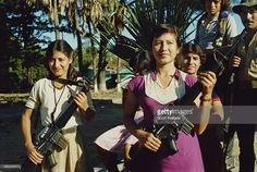Young female guerrilla fighters of the FMLN (Frente Farabundo Martí para la Liberación Nacional or Farabundo Martí National Liberation Front) in El Salvador, during the Salvadoran Civil War, 1985.