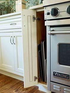 A Slim Cupboard Next To The Oven Keeps Cookie Sheets, Baking Pans, And  Cooling