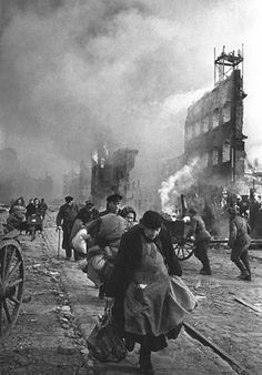 German civilians flee Danzig as it burns, March 1945.  Photo credit: Does anyone know who took this image?