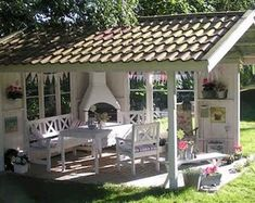 A beautiful idea for an outdoor living space. It reminds me of those horrid par… A beautiful idea for an outdoor living space. It reminds me of those horrid park picnic table shelters, but much more lovely!