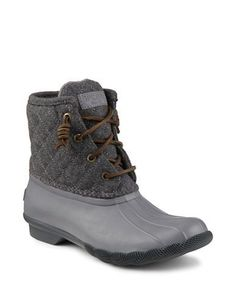 "<ul><li>Duck-inspired quilted boots with lace-up front</li> <li>Block heel, 1"" </li> <li>Wool/rubber upper </li> <li>Side zip closure</li> <li>Microfleece lining </li> <li>Rubber outsole </li> <li>Imported</li></ul>"