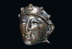 Roman cavalry mask. Iron sheathed in bronze and silver. Sometime before 300 AD.