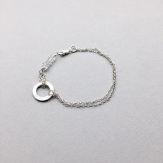 "What comes around, goes around; Circle of Life bracelet is composed of herkimer crystals linked to a handmade pure silver ring charm finished with double layers of sterling silver chains. Size 6.75"" ( $49) #minimalistjewelry #silverjewelry #braceletchain"