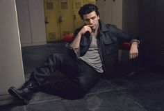DETAILS April 2015 - Oscar Isaac - Jacket by Berluti. Shirt by Dolce & Gabbana. Tank top by Ermenegildo Zegna Couture. Jeans by Burberry Brit. Boots, his own.