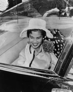 1960 photo Queen Sirikit of Thailand, seated in car, waving, probably during ticker tape parade, New York City graphic / World Telegram & Sun photo by Phil Stanziola.