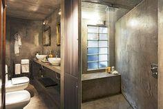 8 propuestas para decorar el baño El cemento alisado es un recurso económico que hay que saber aprovechar. En caso de aplicarlo en un baño, poné especial atención a la iluminación para darle calidez y luz al espacio. / Archivo LIVING