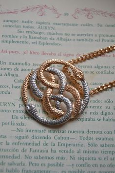 The auryn necklace from the neverending story movie would make a the auryn necklace from the neverending story movie would make a great tattoo jewelry pinterest neverending story movie tattoo and piercing mozeypictures Choice Image