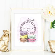 Ladurée wall art, macrons, luxury treats, desserts, wall decor, typography art poster, watercolour illustration, high fashion wall art. stylish home decor. Macarons by Ladurée, Paris.  Ladurée is a French luxury bakery and sweets maker house created in 1862. They are known as one of the makers of macarons in the world. With colors of every palette, it is truly gorgeous as an artwork to display and bring to your home a taste of Paris. Signed with the official Couture Printery signature at the…