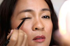 For easy winged eyeliner, here's a tutorial.   I tightlined my eyes first, because I always tightline, but it's completely optional. What we're gonna do now is line our upper lash line, so grab a black pencil eyeliner with a sharp tip (or sharpen a dull one), and line the upper lash line on one of your eyes with it. The sharp tip just makes it easier to be precise than a dull or blunt tip does.