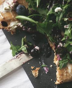 blueberry balsamic + goat cheese flatbread with arugula