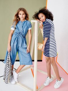 J.Crew girls' chambray jumpsuit, short-sleeve pocket T-shirt, striped cardigan sweater and Adidas® Stan Smith™ sneakers. J.Crew girls' mixed-stripe shift dress, glitter orange slice bag and Adidas Stan Smith sneakers.