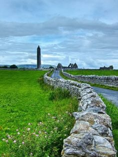 Kilmacduagh Monastery and round tower in County Galway, Ireland. by verna