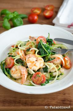 Zoodles with Shrimps and Spinach     4 zucchini, spiralized     3 tbsp coconut oil     2 onions , thinly sliced     3 cloves garlic, minced     300 gr (about 5 cups, pressed) fresh spinach     3 tbsp olive oil     500 gr (about 1 pound) tiger prawns     200 gr (about 2 cups) cherry tomato, halved     handful of fresh basil leaves, torn     celtic sea salt and freshly ground peper