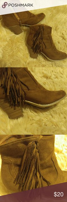 MUST HAVE: Brown Leather Fringe Tassle Boots Brown Vegan Leather Fringe Tassle Boots... BEAUTIFUL!! Size 9. Great working zippers. Classy fringe. 3 inch heal. No imperfections except for slight tread on bottoms of shoes. You can nearly pair these with every outfit!! Man made materials. Take these home and love them!!! Bundle and save 30% when you purchase 3+ items !! Wet Seal Shoes