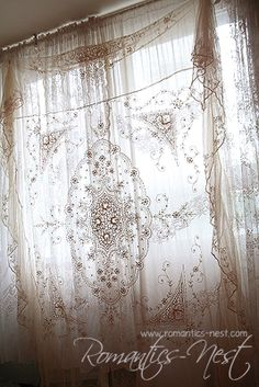 *Lace curtains, although I think this is a laces tablecloth hung up over sheer curtains, same affect