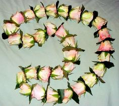 Handmade fresh rose lei - a symbol of good luck and congratulations for all occasions!