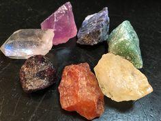 Chakra Stone Set with Selenite wand (8 piece set) Listing is for (1) set of raw gemstones which include 7 stones (Black Tourmaline, Carnelian, Yellow Calcite, Green Aventurine, Sodalite, Amethyst, Qua