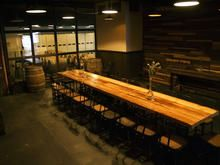 Rustic plank tables.  Use of barrels in the back.