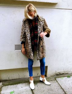 Reach for a camel animal fur coat and blue slim jeans to achieve a chic look. Complement this look with white cutout leather ankle boots.  Shop this look for $103:  http://lookastic.com/women/looks/red-scarf-blue-skinny-jeans-white-ankle-boots-camel-fur-coat/934  — Red Plaid Scarf  — Blue Skinny Jeans  — White Cutout Leather Ankle Boots  — Camel Leopard Fur Coat