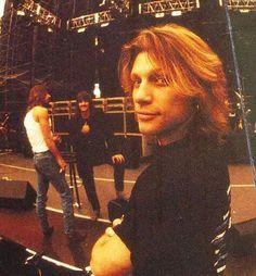 Jon Bon Jovi and Richie Sambora (in background) circa 1994/1995