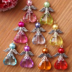Made using acrylic pearl and faceted acrylic heart beads. NOTE Colour may vary slightly due to individual monitor set up. Set of 9 or 18 handmade Angel/Fairy charms.   eBay!