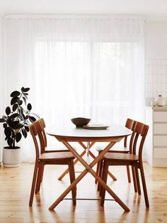 minimalist-decorating-ideas-white-dining-room-wooden-table