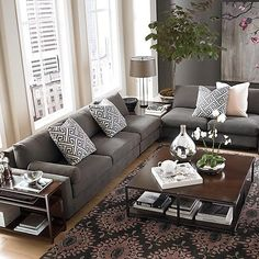 The L-shaped sectional sofa has the charcoal gray color,