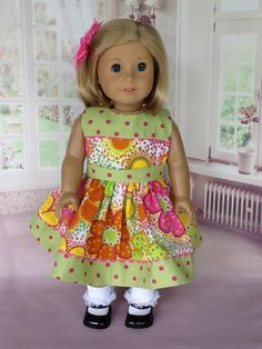 18 inch doll dress and hair clip. Fits American Girl Dolls.