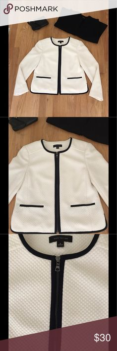 """Ann Taylor White And Black Suit Jacket NWOT Size 6 Ann Taylor New Without Tags Zippered White Suit Jacket With Black Piping. Fully Lined. Underarm To Underarm 16"""". Shoulder To Base 19.25"""". Shell 84% Polyester, 16% Rayon. Lining 100% Polyester. Ann Taylor Jackets & Coats"""