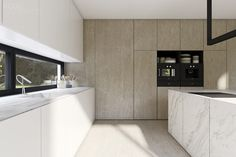 KITCHEN INSPIRATION - A gorgeous mix of materials take center stage in this minimal kitchen by Kuoo Architects.